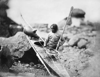 Inuit with Skin on Frame Kayak
